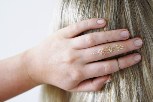 Gold and white bindi temporary tattoos