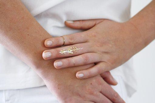 Gold and white bindi temporary tattoos