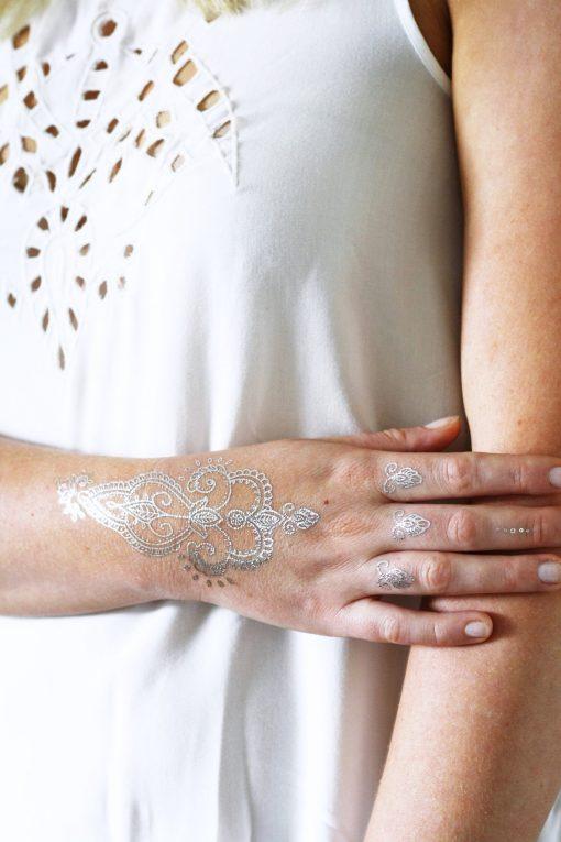 Delicate silver henna temporary tattoo