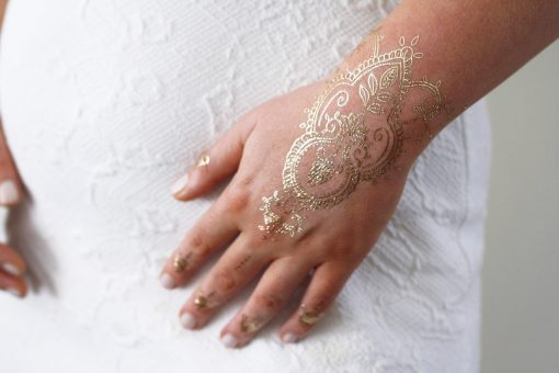 Gold henna hand temporary tattoo