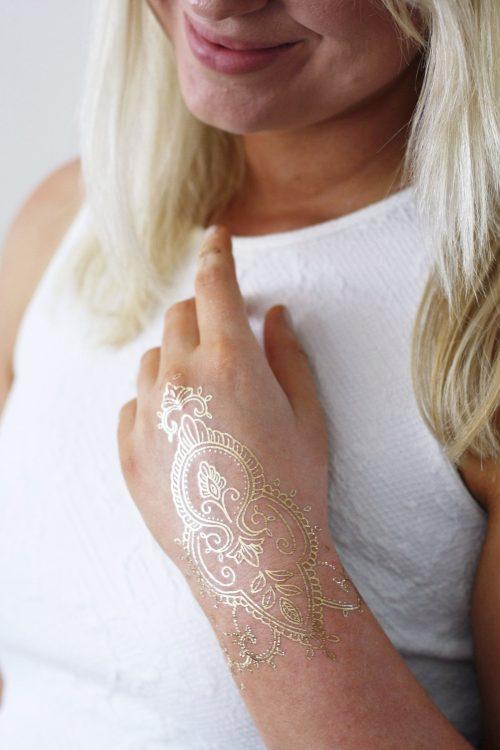 Gold henna hand temporary tattoo