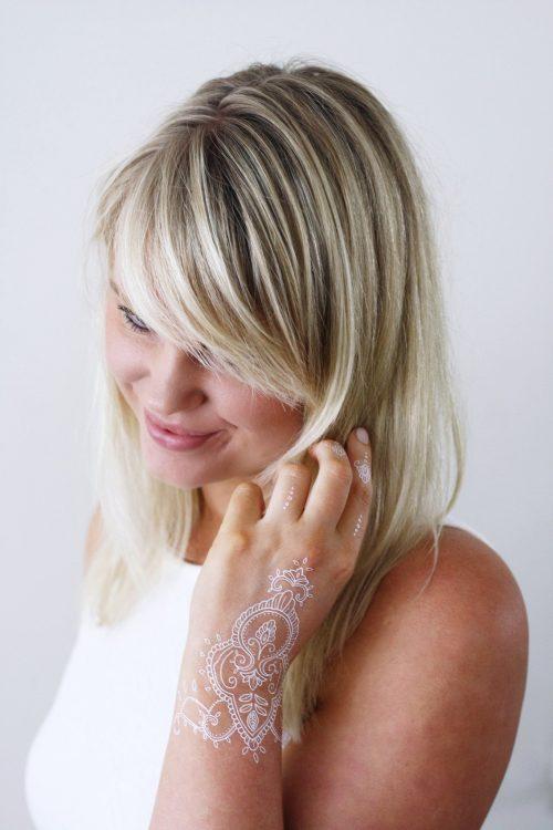 White henna hand temporary tattoo