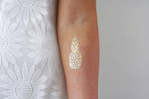 Gold pineapple temporary tattoo