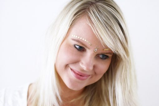 Gold and white face temporary tattoos