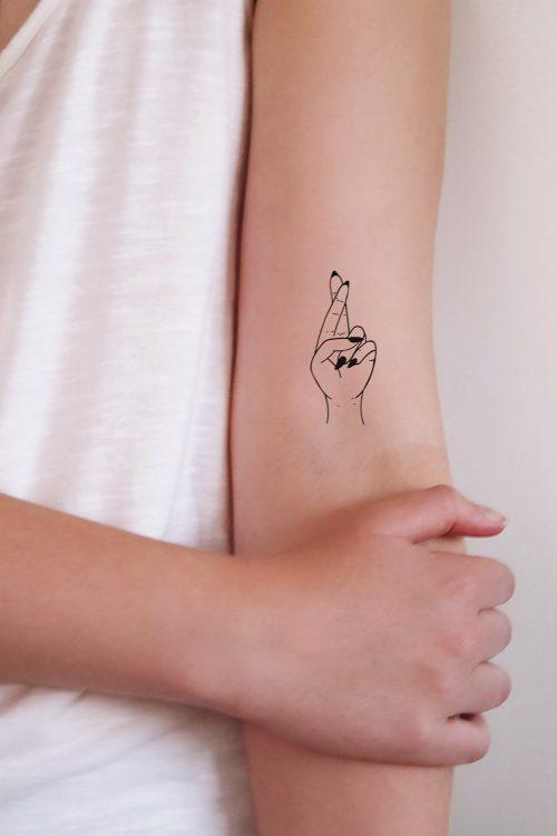Fingers crossed temporary tattoo