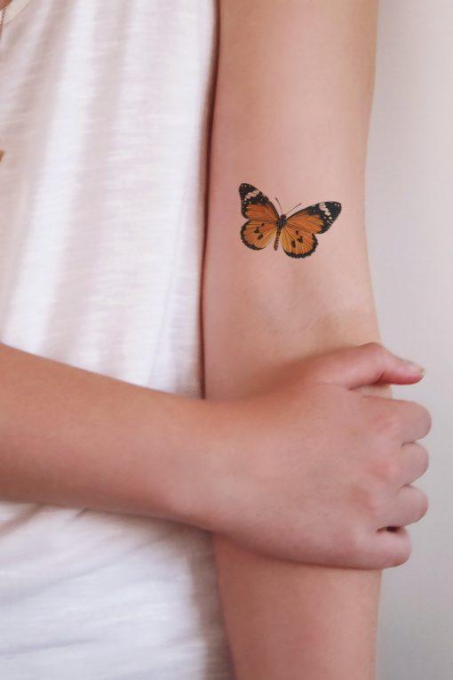 Orange butterfly temporary tattoo