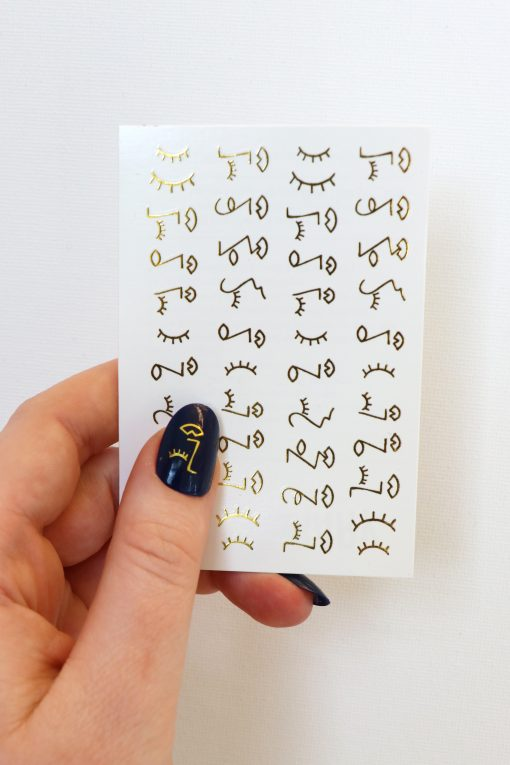 faces in gold nail decals