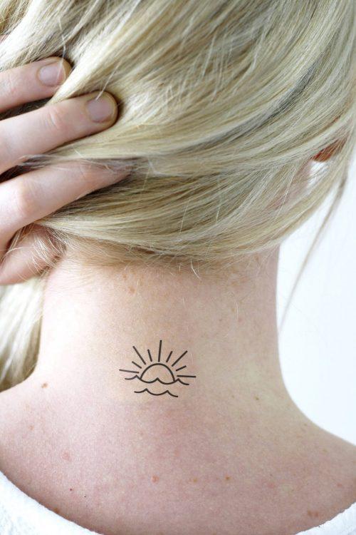 sun set above sea temporary tattoo