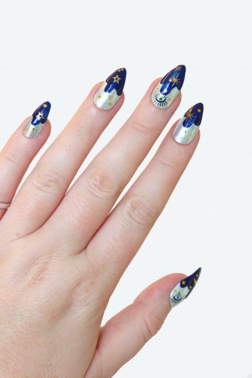 Stars moon and eye nail tattoos